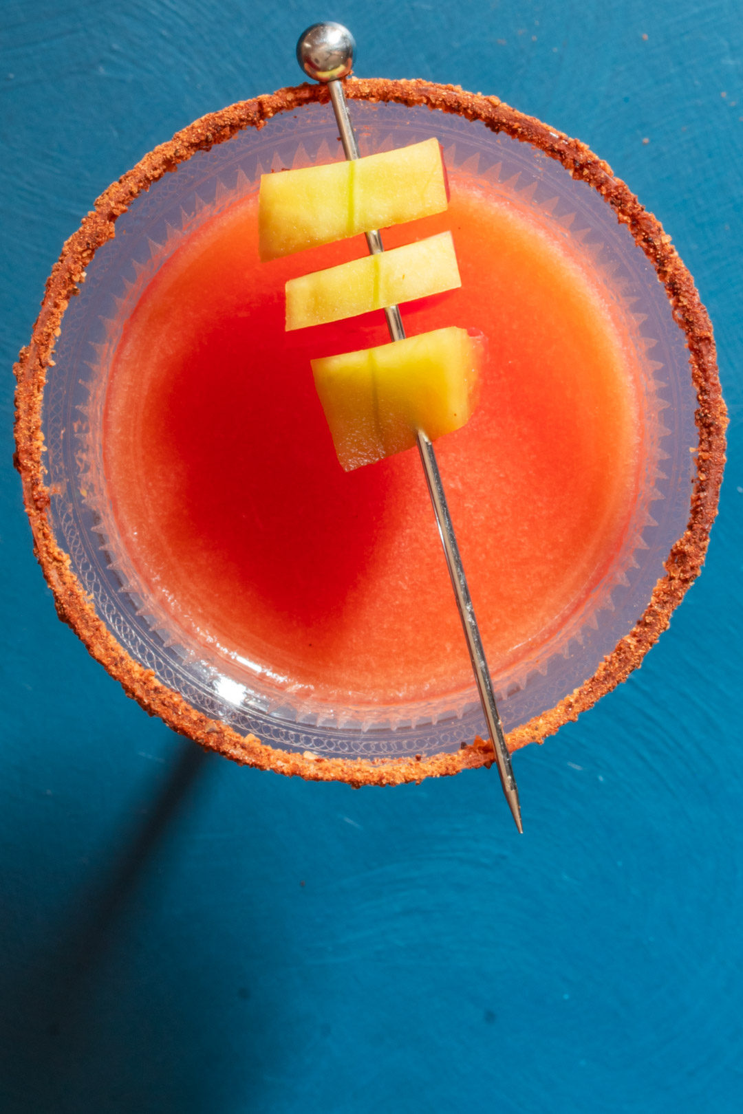 Pickled watermelon rind margarita cocktail with chili-lime-cinnamon salt: from above with small shadow