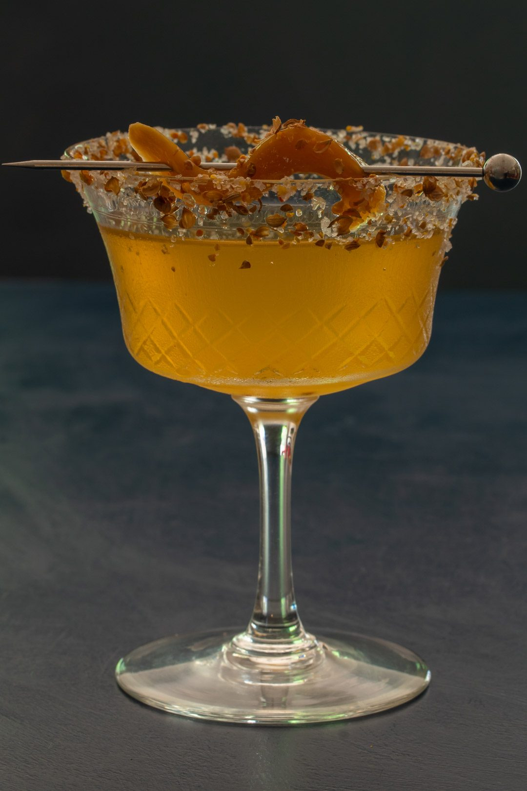 Pickled green mango margarita cocktail with orange coriander salt: eye level