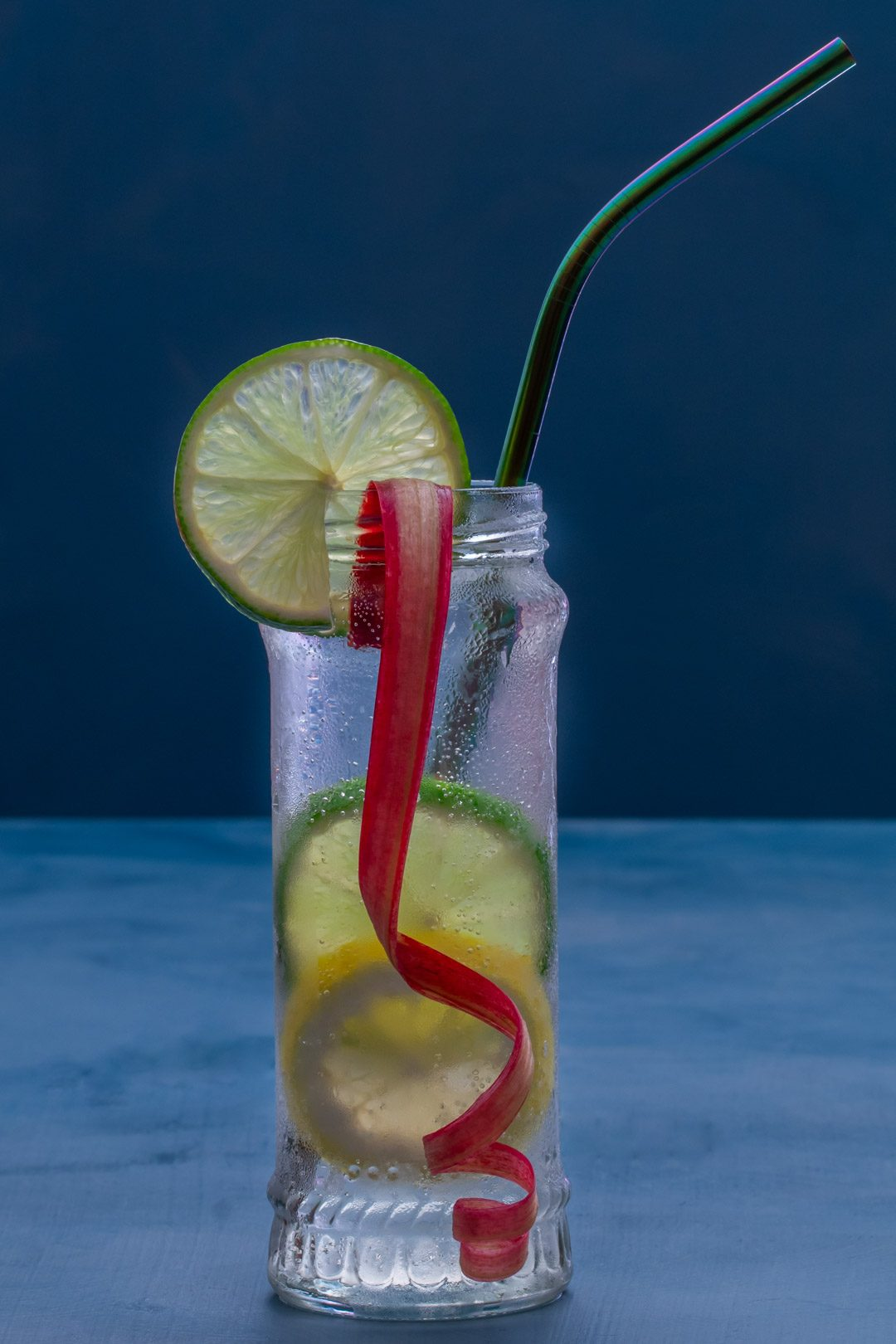 lemon, lime and rhubarb bitters with straw right