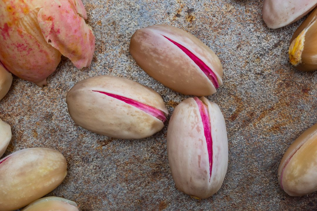 close up of pistachios used for making pistachio rose water orgeat syrup