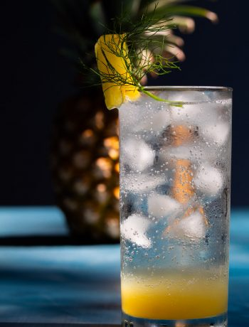 pineapple fennel shrub syrup with pineapple in background