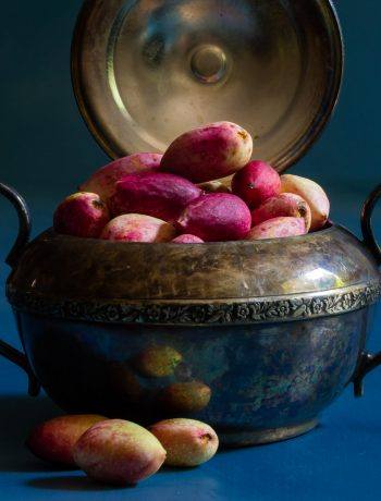 making pistachio rose water orgeat syrup with fresh pistachios in antique sugar bowl