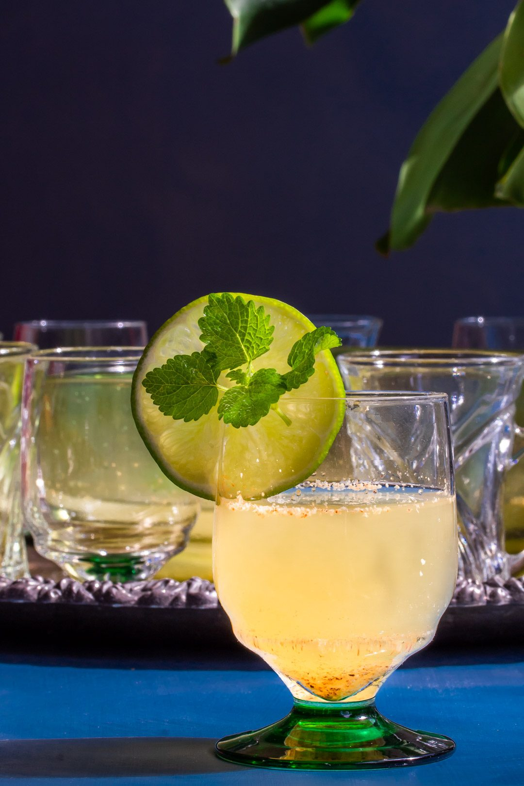 coconut palm arrack punch with glasses in background