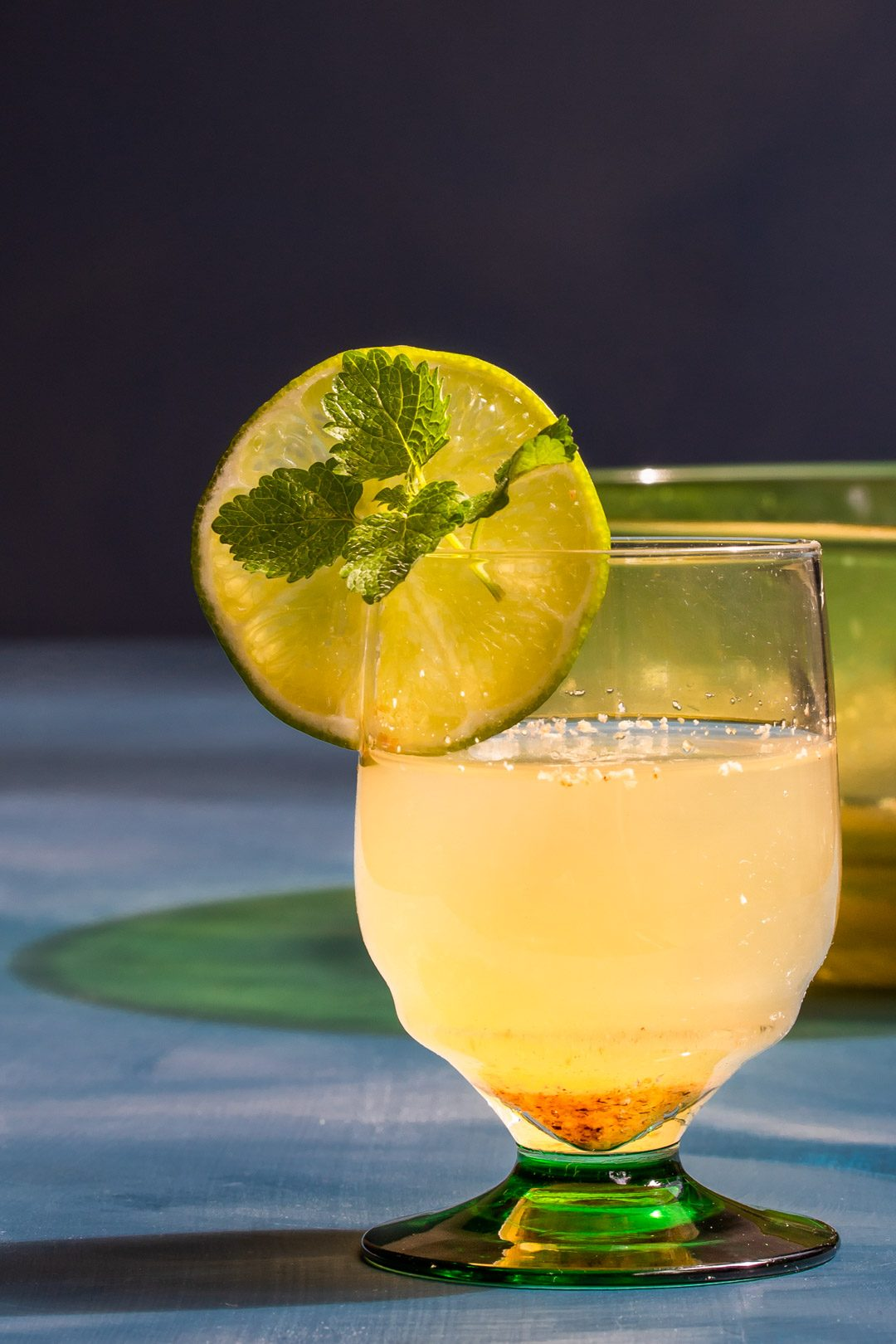 coconut palm arrack punch with green glass bowl in background