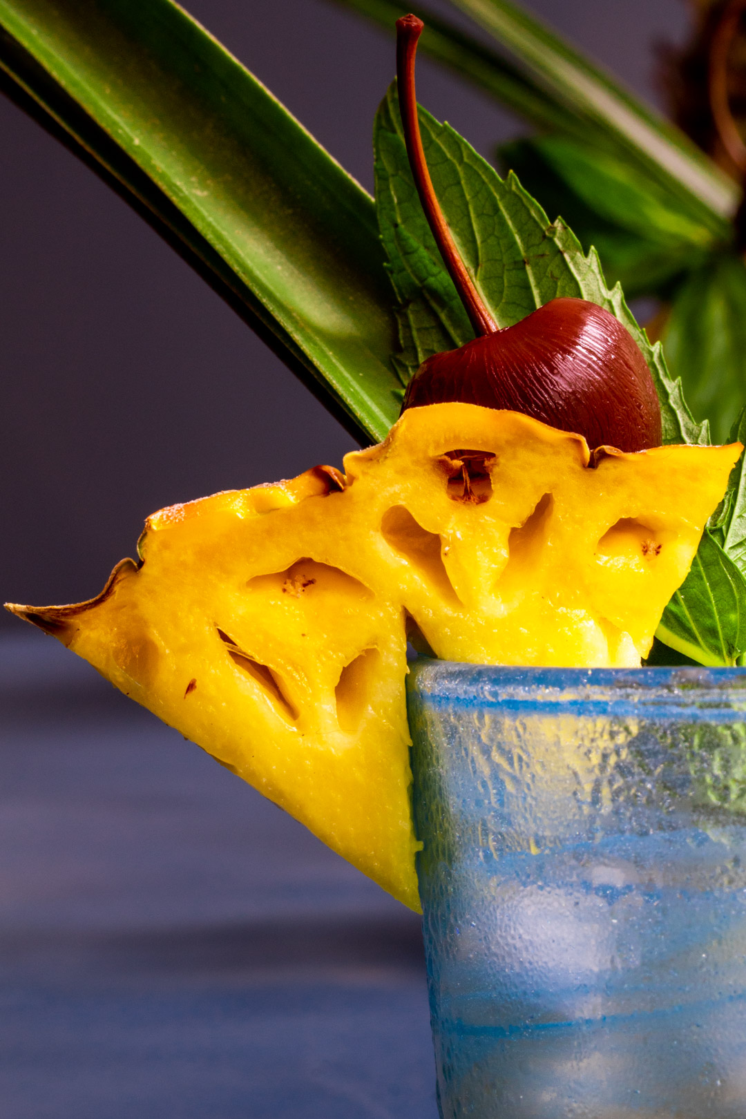 Pickle Mai Tai cocktail close up of pineapple garnish