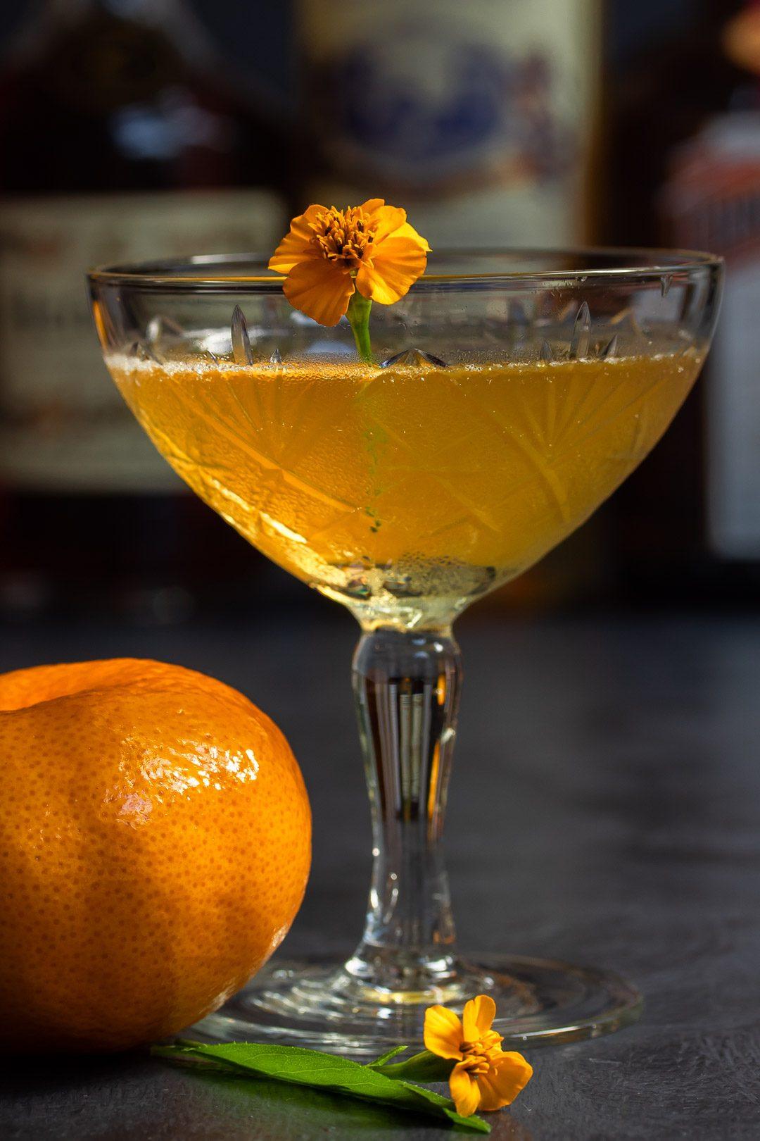Mandarin pickle Hoop la! Cocktail eye level with bottles in background