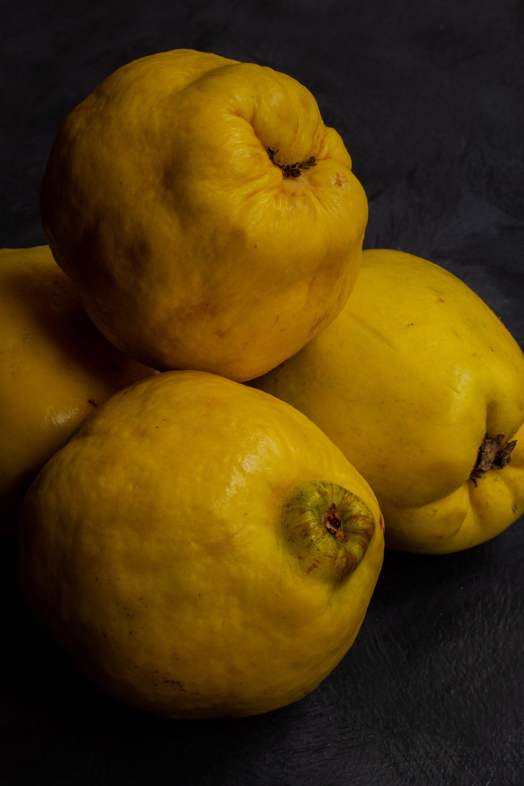 Making Vintage Quince Cordial with quinces in pile from above