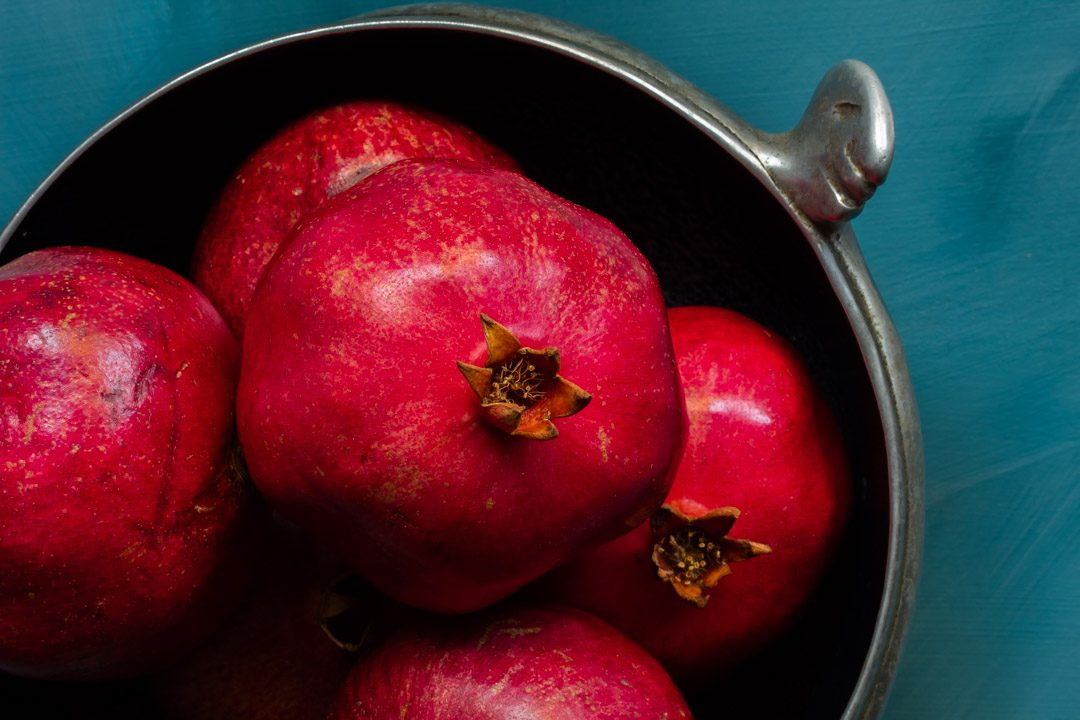 metal bowl of pomegranates used to make grenadine from above