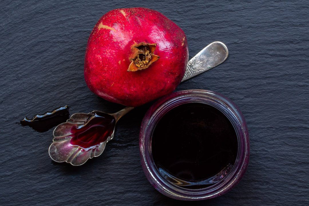grenadine or pomegranate syrup from above with vintage spoon and pomegranate