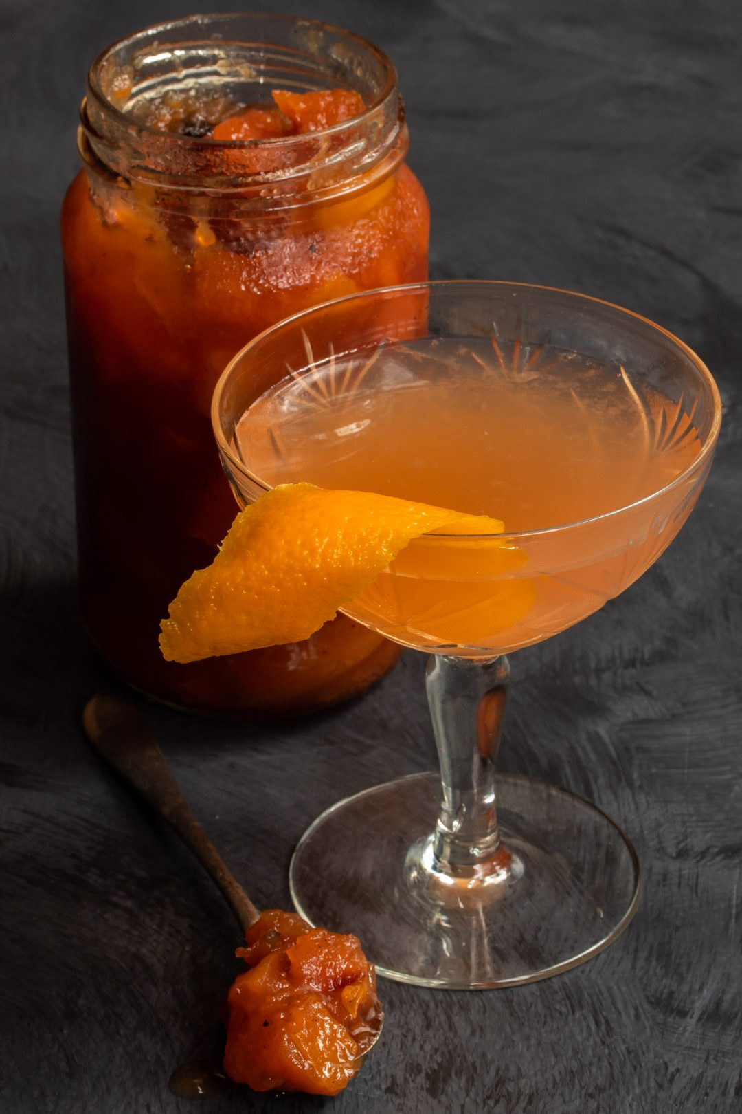 quince apple jam gin sour cocktail from 45 degrees with spoon of jam and jam jar