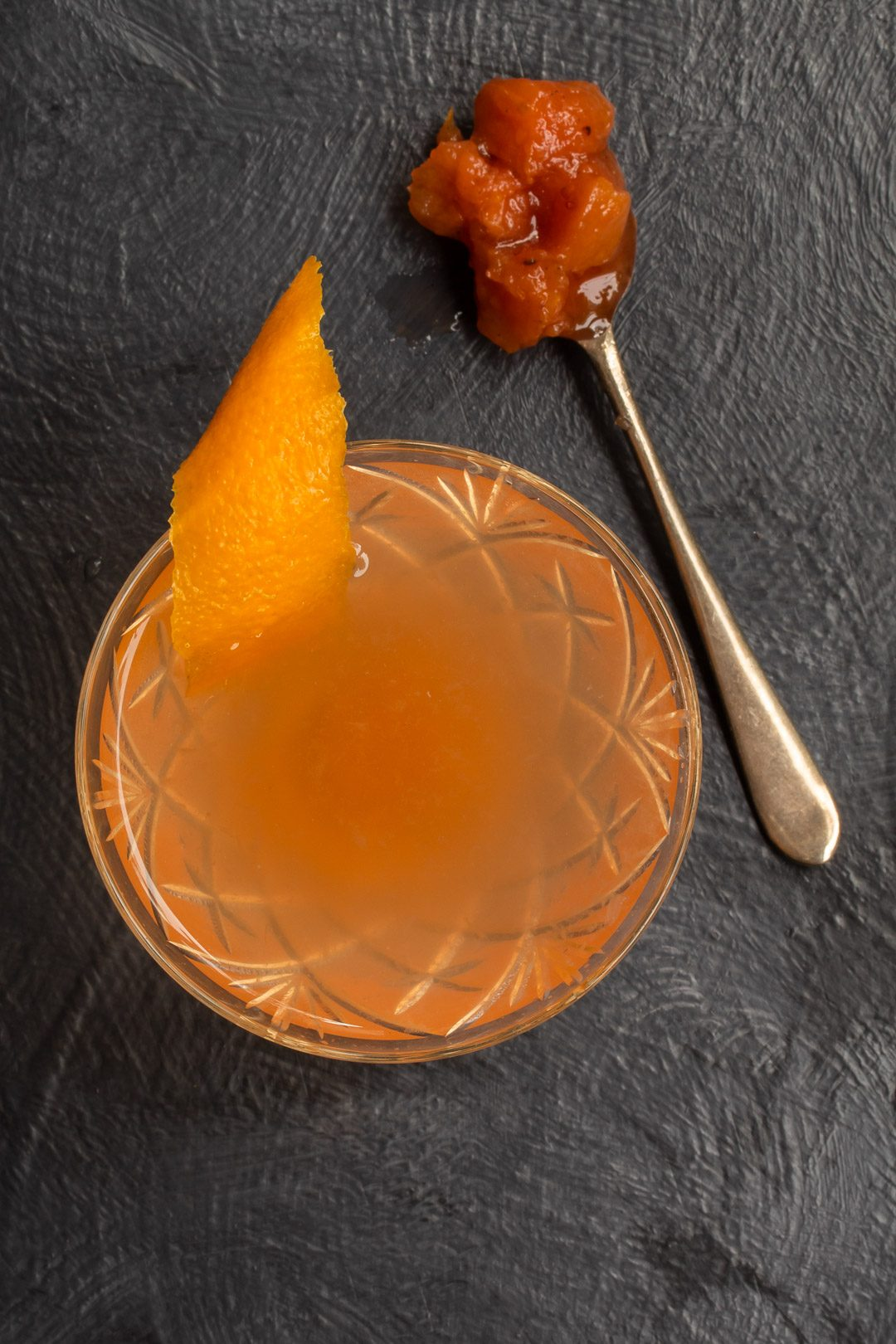 quince apple jam gin sour cocktail from above with spoon of jam