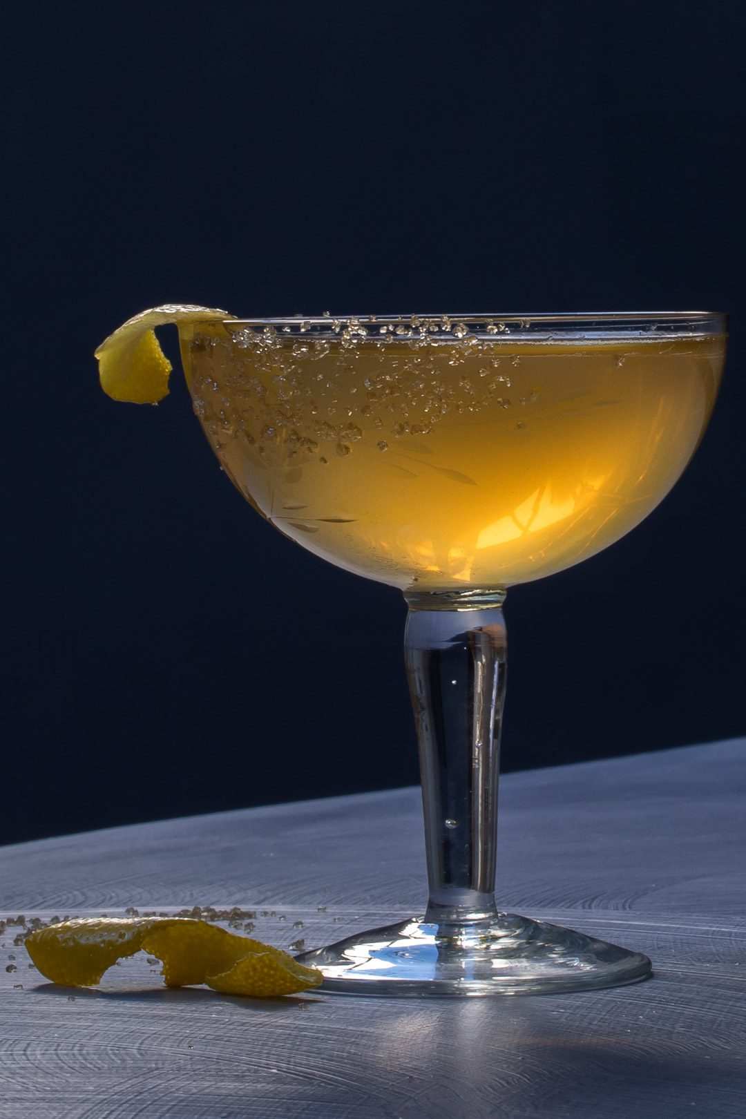 Fancy quince brandy champagne cocktail with tilt horizon