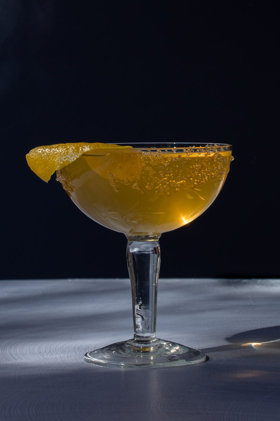 fancy quince brandy champagne cocktail with highlight and shadows