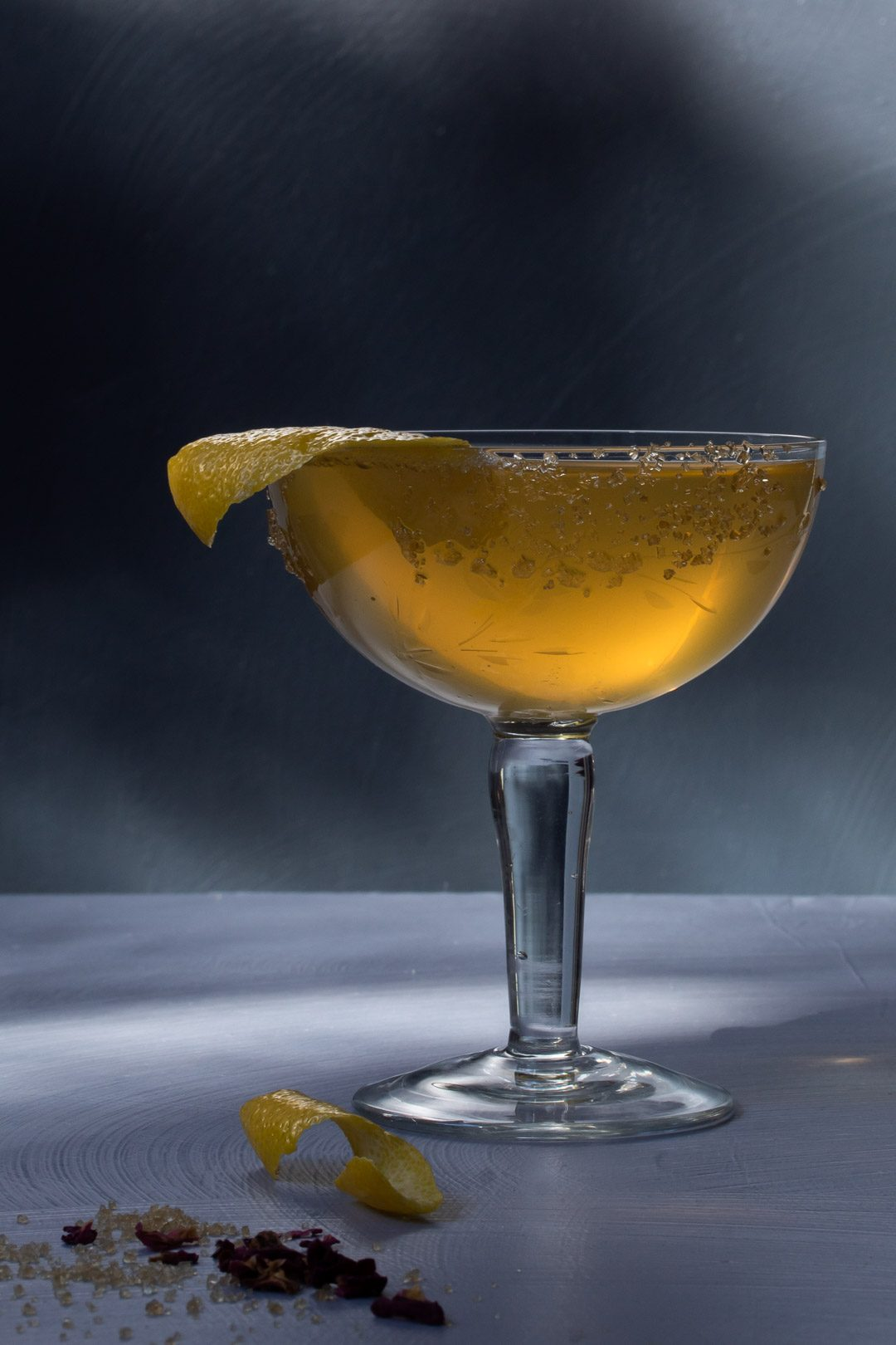 Fancy quince brandy champagne cocktail with light and shadows