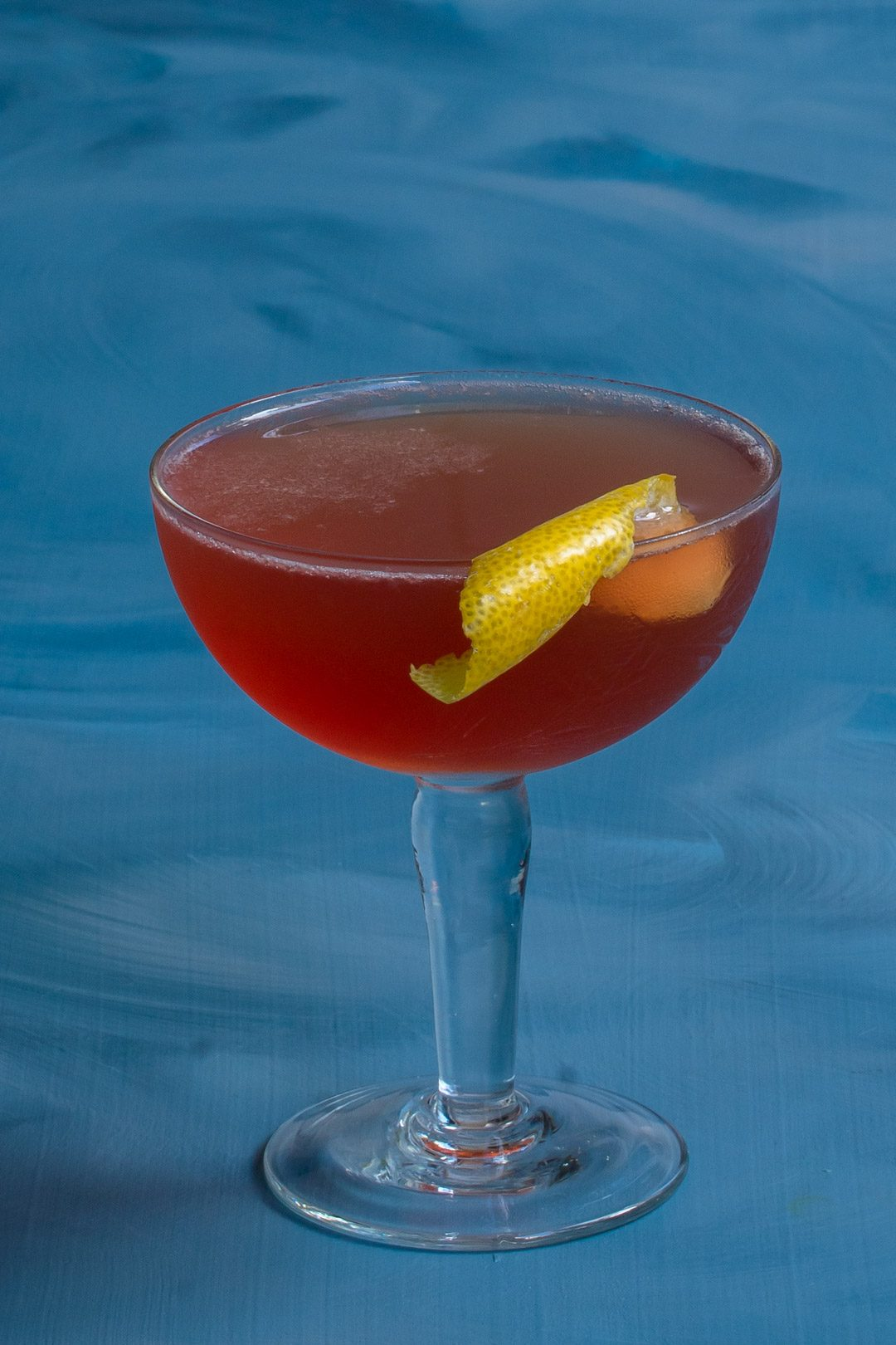 Harry's pick me up cocktail isolated on blue background