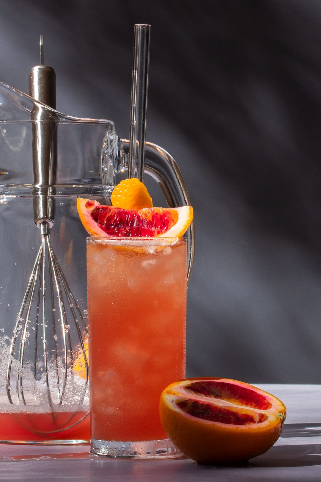 making improved blood orangeade with jug and whisk