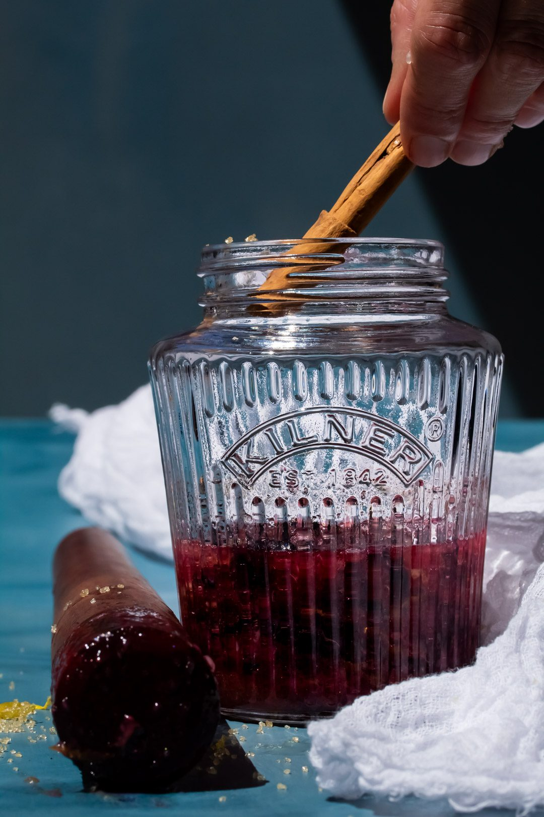 making blueberry shrub syrup, adding a cinnamon stick