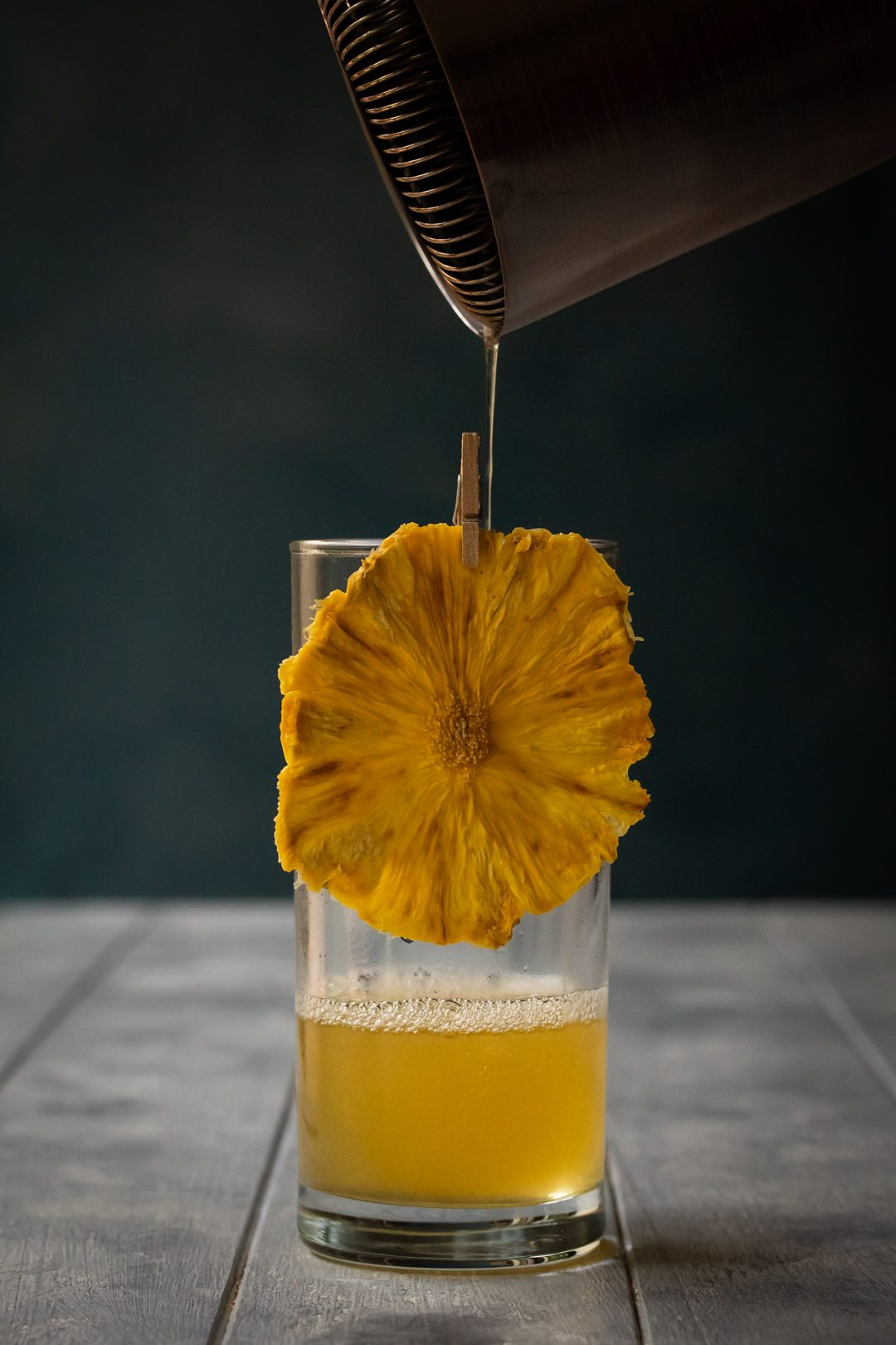 pouring rum, lemon and honey for pineapple fiz