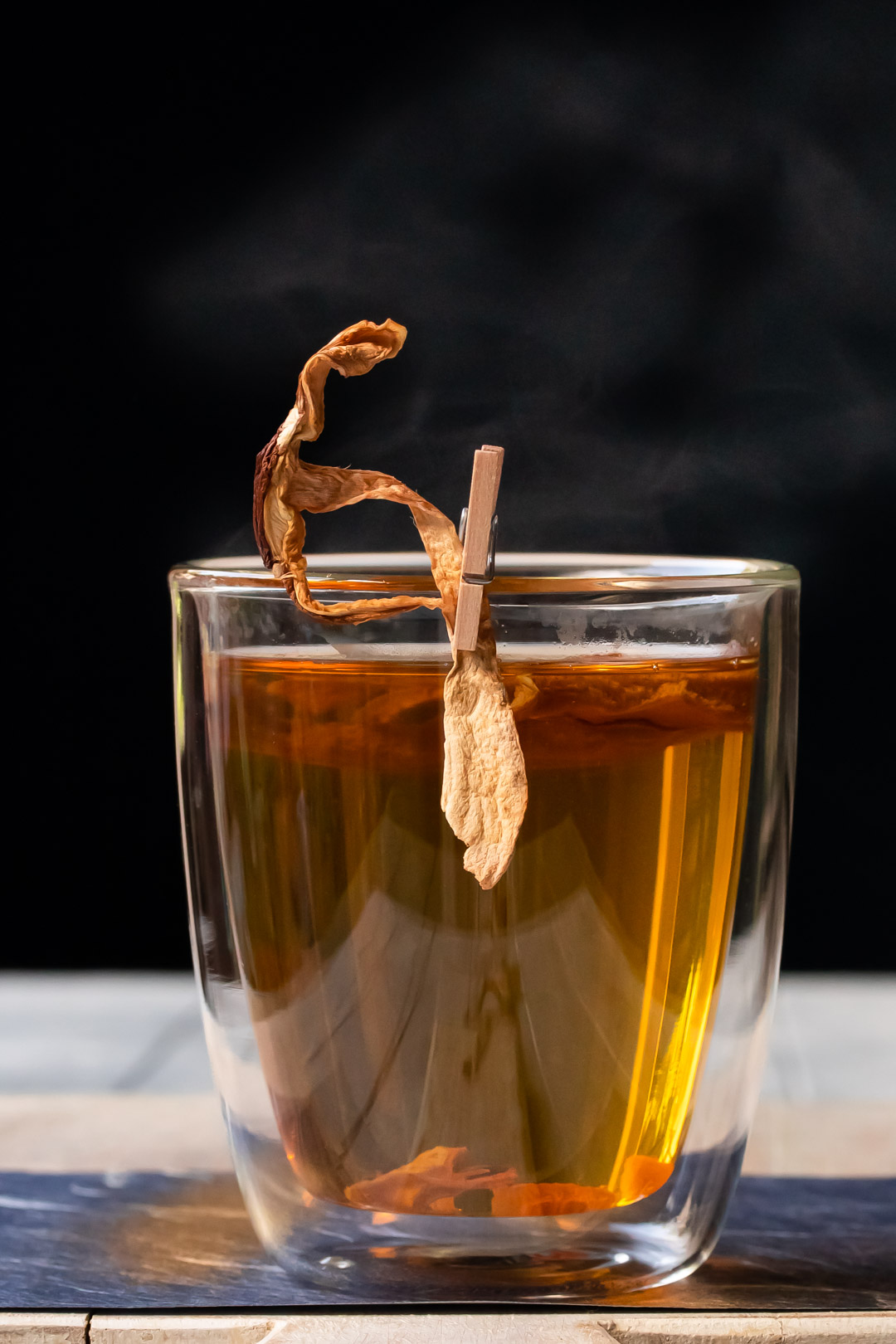 umami hot whiskey toddy with shiitake mushrooms and steam