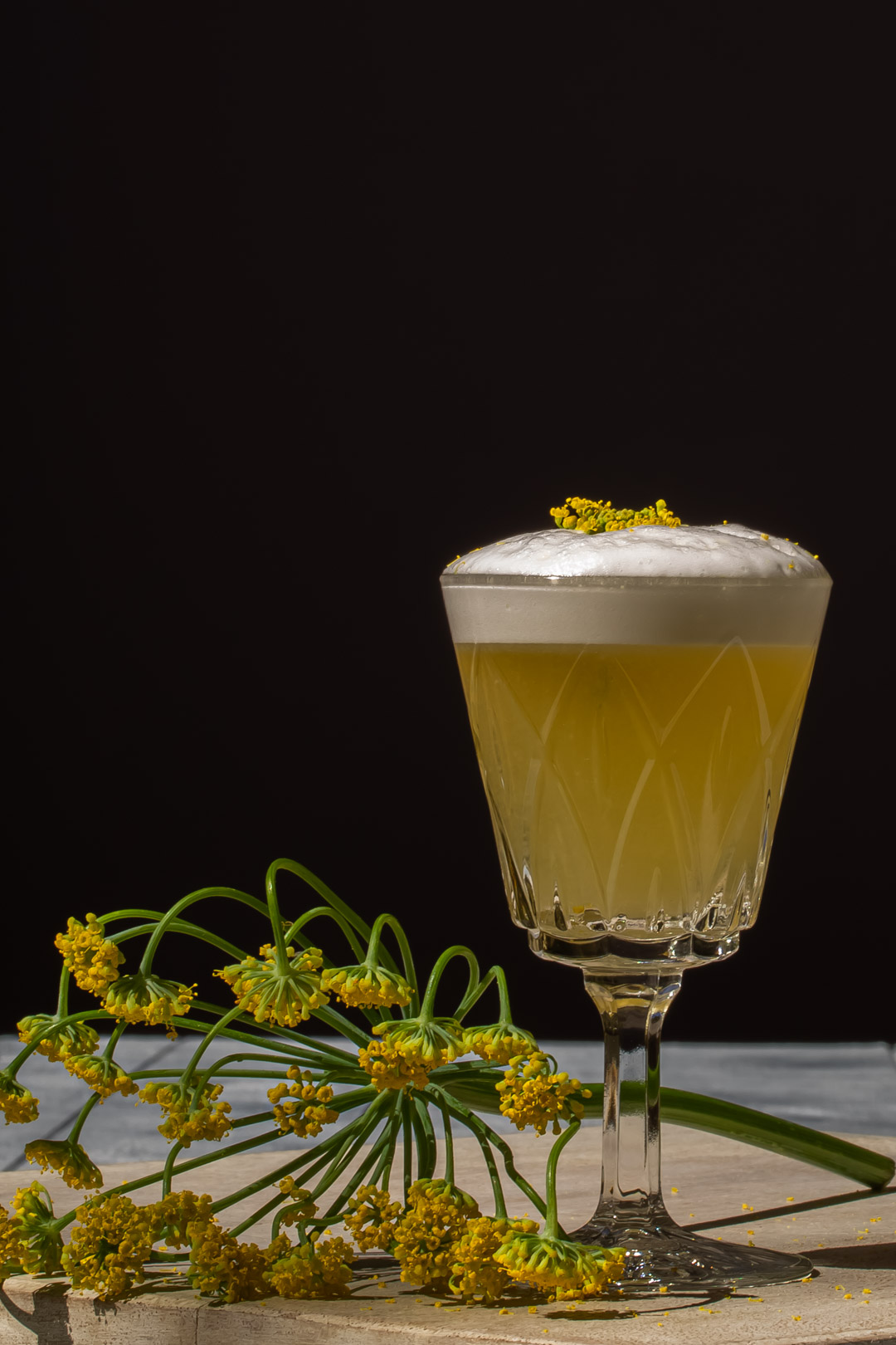 fennel flower silver sour to right with fennel umbrel and fennel flower garnish