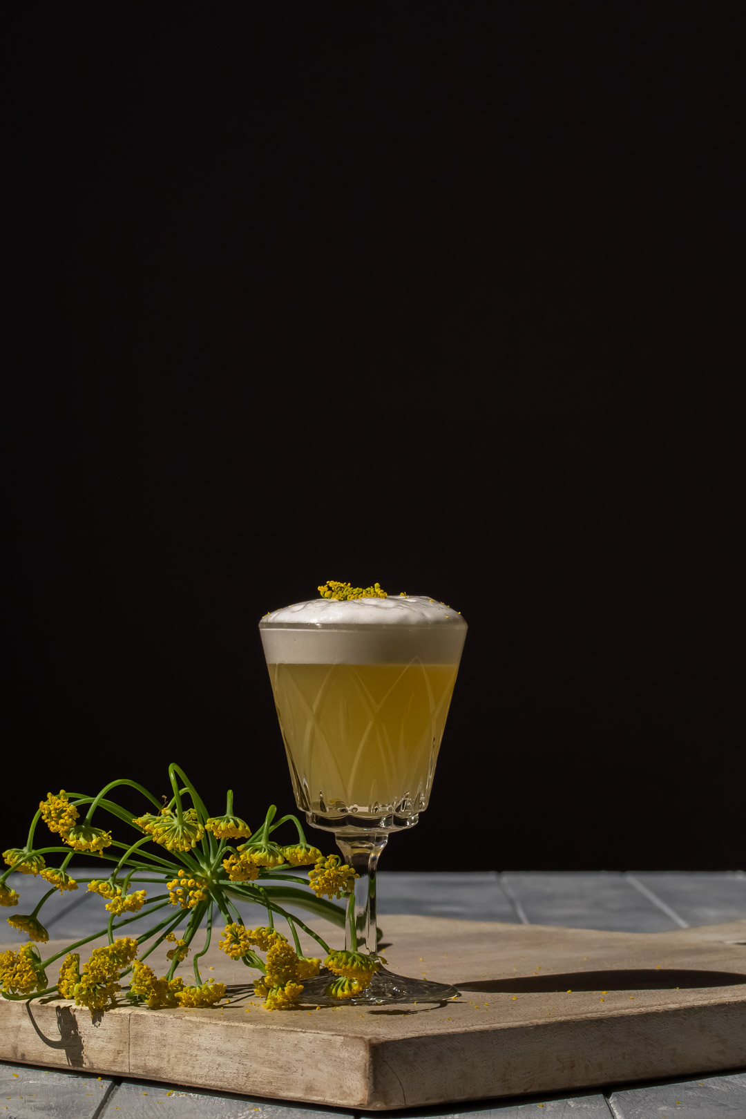 fennel flower silver sour with fennel flower garnish and fennel umbrel to left