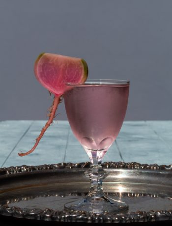 fermented watermelon radish martini on vintage silver tray