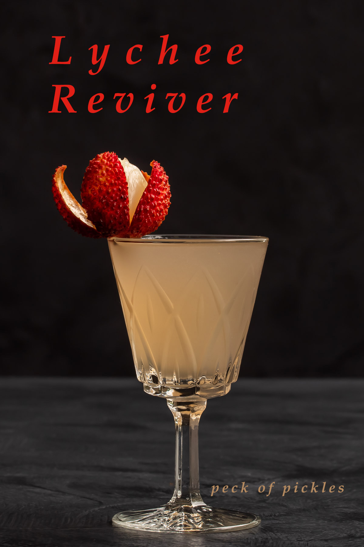 lychee reviver cocktail with lychee garnish