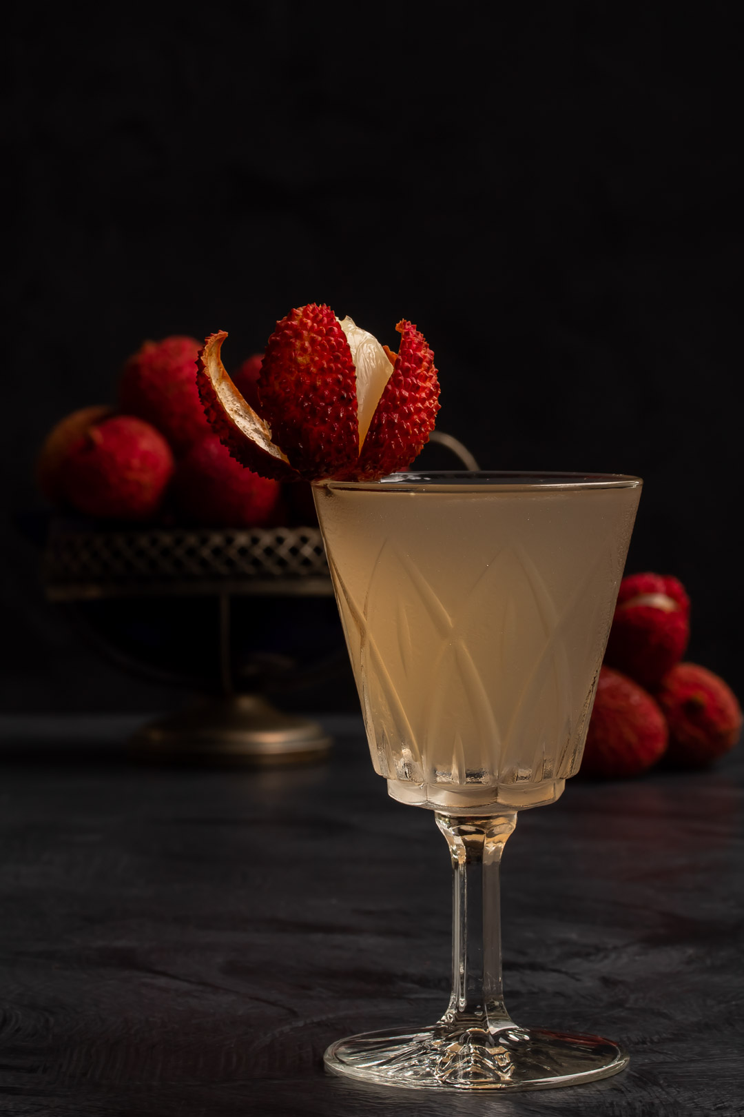 lychee reviver with lychees in background