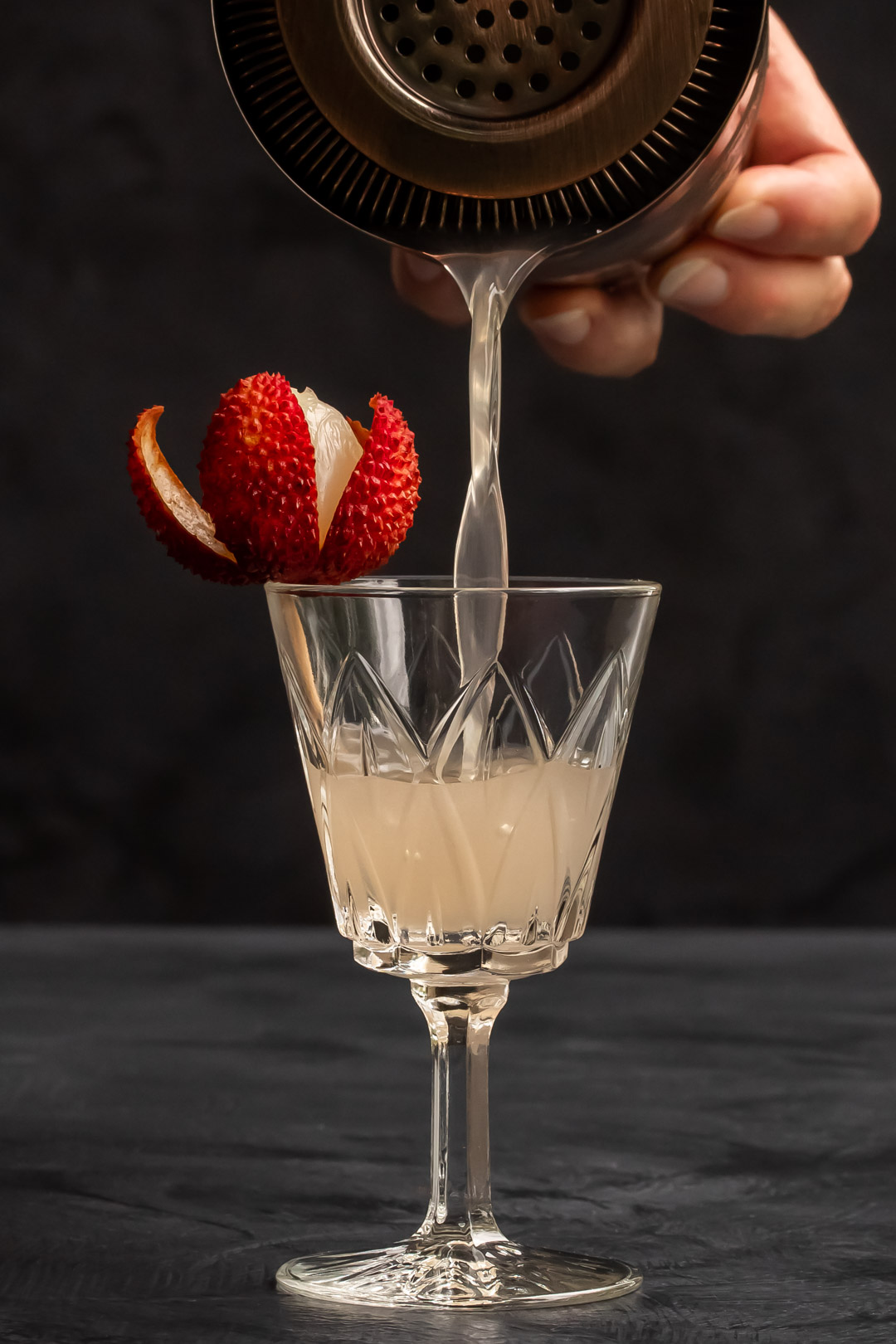 more pouring lychee reviver with lychee garnish